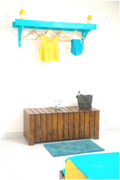 Bedroom with a custom clothes rack and the uByld Jarawa
